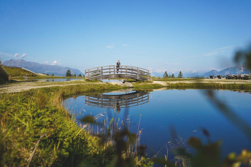 Muttereralm-Panoramasee-Speichersee-Bruecke-Tirol-Oesterreich